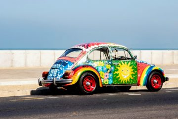 multicolored-volkswagen-beetle-on-road-3716637